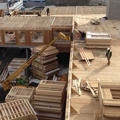 Manufactured trusses and wall panels at jobsite
